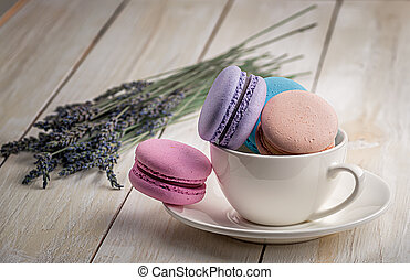 Macaroons in white cup with lavender