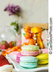 Macaroons of different tastes on a white plate