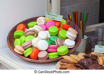 Macaroons on display in a bakery window