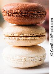 Three colors of macaroons in brown and beige tones