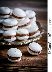 Macaroons with chocolate and nut filling
