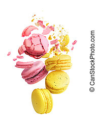 macaroons with crumbs flying on a white background