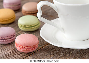 Macaroons with cup of coffee