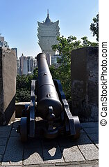 Macau, China - Oct 28, 2016. Cannon of Mont Fortress point at Grand Lisboa building.