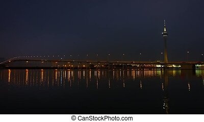 """""""Macau Tower at night, with urban traffic crossing a bridge in foreground"""""""
