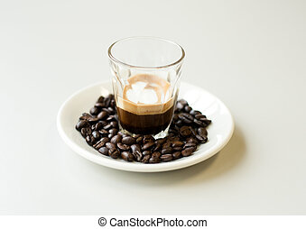 Macchiato is Italian espresso. Usually people in Italy drink it during breakfast.