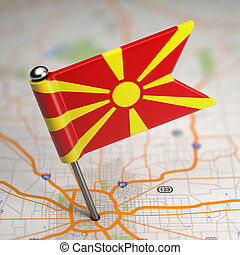 Small Flag Republic of Macedonia on a Map Background with Selective Focus.
