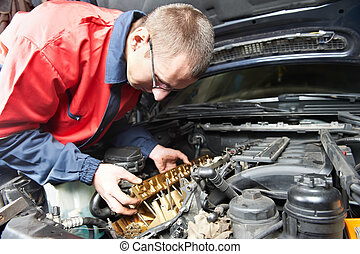 machanic repairman at automobile car engine repair - ...