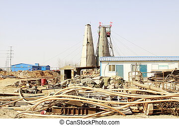 MACHENG - March 13: Intricately stacked with all kinds of materials in MaCheng iron mine, on march 13, 2014, Luannan County, Hebei Province, China