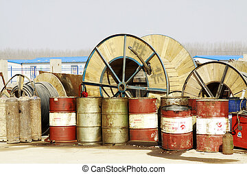 MACHENG - March 13: Oil drums and electric power equipment on construction sites in MaCheng iron mine on march 13, 2014, Luannan County, Hebei Province, China