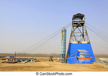 MACHENG - MARCH 26: Drilling derrick in MaCheng iron mine March 26, 2013, Luannan County, Hebei Province, China