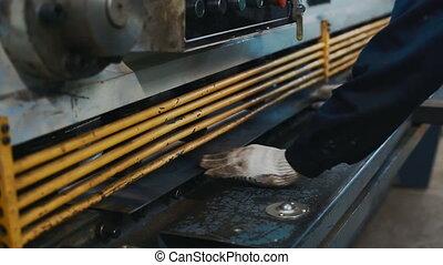 machine cutting metal sheet in factory