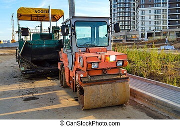 machine for creating an improved surface on the road next to the roller. devices for road construction. urban landscape, highway creation.