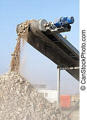 Machine for crushing stone. Falling rocks