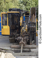 machine for drilling holes in the ground.