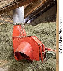 Machine for making hay bales, barn in Austria