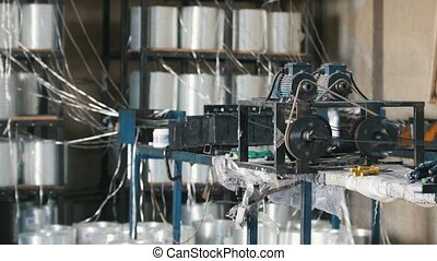 Machine grinds the glass for production fiberglass...