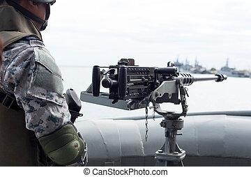 Machine gun and navy guard on the war ship