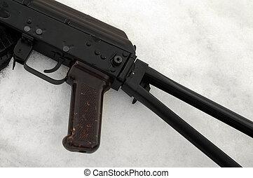 Machine gun on the snow