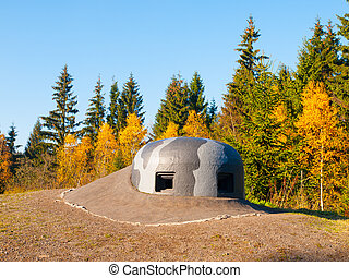 Machine gun turret with camouflage paintings on military bunker
