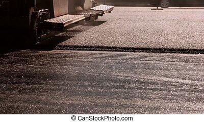 Machine making layer of asphalt. Texture of road. Make roads...