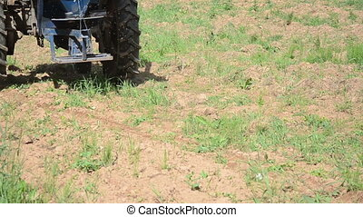 machine seed sow field - Closeup of special machine tractor...