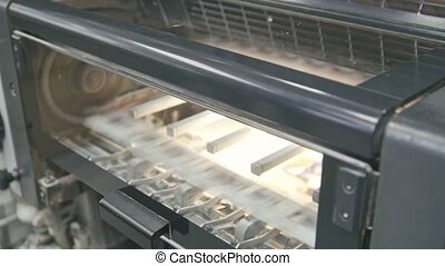 Machine working in printing house, polygraph industry -...