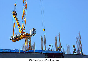machinery crane in construction site building industry with laborer working