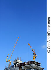 machinery crane working in construction site building