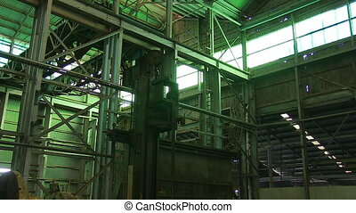Machines inside a warehouse - A medium shot of machines on a...