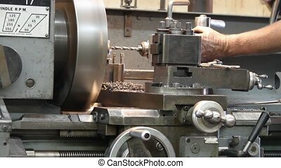 boring machine - machinest bores hole in metal in boring...