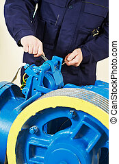 Machinist tuning elevator brakes mechanism