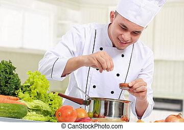 macho, chef, mientras, cocina
