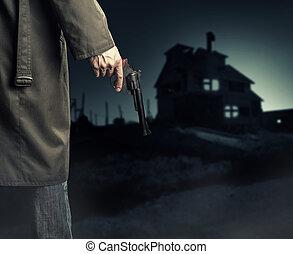 macho, mão, com, arma, (revolver), ao ar livre