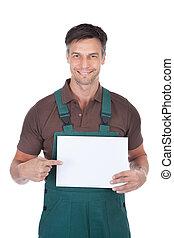 macho, painél publicitário, jardineiro, segurando, em branco