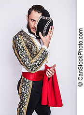 Macho - Male dressed as matador. Isolated studio portrait...