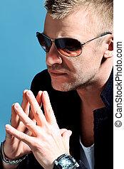 macho - Portrait of a handsome man in sunglasses. Studio...