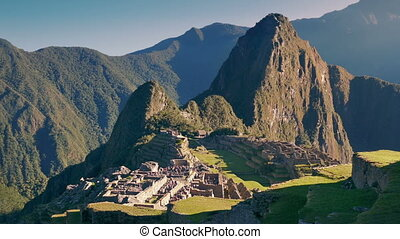 Machu Picchu In The Sun With People Walking Around