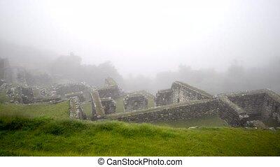 Machu Picchu ruins - ancient ruins of Machu Picchu in deep...
