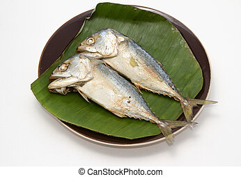 mackerel fish on banana leaf