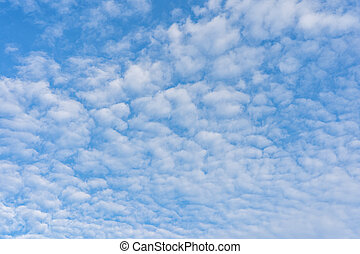Mackerel sky with white clouds on day time for background usage