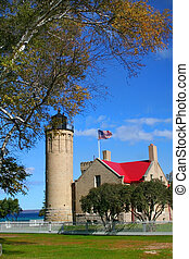 Historic Mackinac Light house with blue sky background