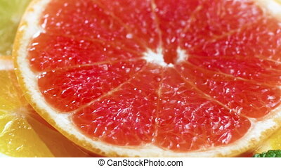 Macro 4k footage of orange, grapefruit and lemon slice lying on table