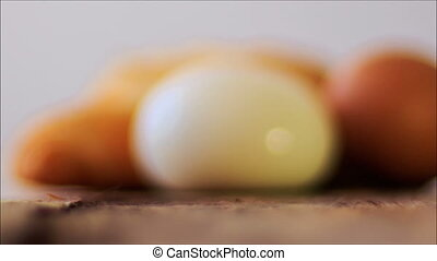Macro Big Rubicund Cruasan behind Shelled Egg on Table -...