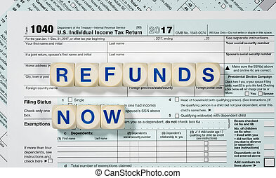 Macro close up of 2017 IRS form 1040 with REFUNDS NOW...