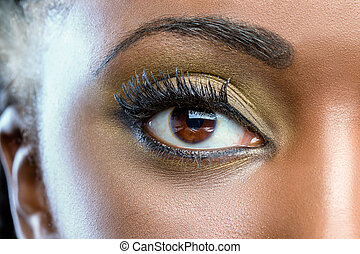 Macro close up of african eye with make up.