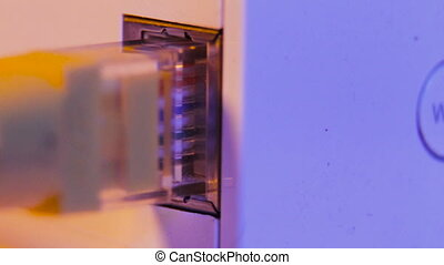 Macro close up of WiFi extender in electrical socket on the...