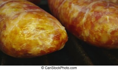 Macro close-up shot of sausages on a grill