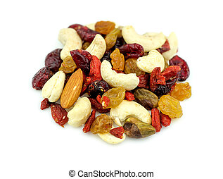 Macro closeup of mixed nuts and dried fruits isolated on white