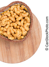 Macro closeup snacks with peanuts on a wooden board